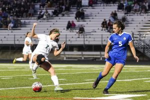 Edina freshman Haley Reeck (7) attacks goal on Minnetonka defender Kayla Mahabadi (5) in the first half. Reeck would later score the game winning goal in double overtime for a 1-0 victory over Minnetonka at Shakopee West Junior High School. Photo by Travis Ellison, SportsEngine